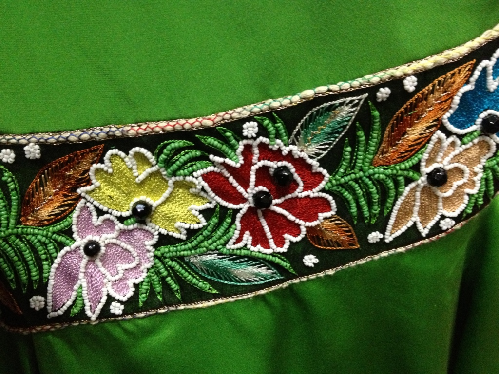 I couldn't resist posting the beading detail from one of Nicole's dresses.  You should go look at the fashion show, but you won't be able to see all the wonderful details in her dresses!