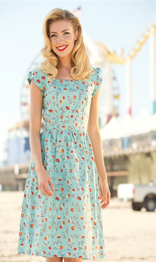 Lovely shaped dress in blue with a floral print