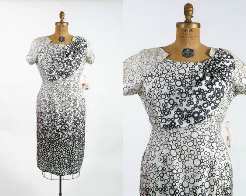 The use of the fabric print on this 1950's dress is pretty fascinating - excellent neckline, as well