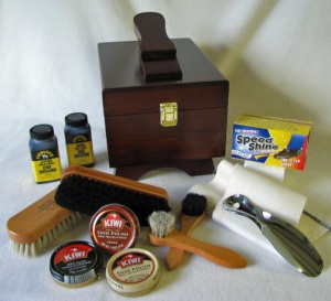 My dad has had one of these mega shoe shine kits with the swanky wooden box for as long as I can remember.  When you have to special order extra narrow shoes, replacing them can get expensive.  I used to consider it a privilege to sit down with my dad and help him polish his shoes (is that weird?) and I always loved the results - shiny!