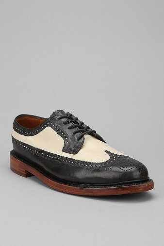 Men's Florsheim wingtip oxford in this juicy color combo of cream and black.  This shoe is also available in 5 solid colors: gray, maroon, black, berry, and brown.
