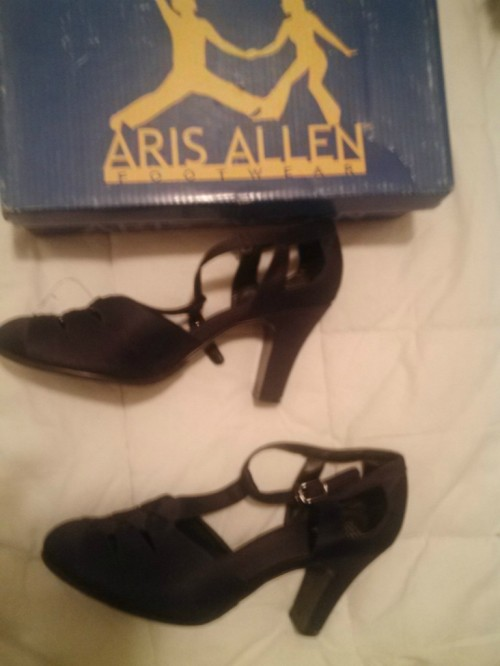 Black t-strap heels, size 8, bidding starts at $14.99