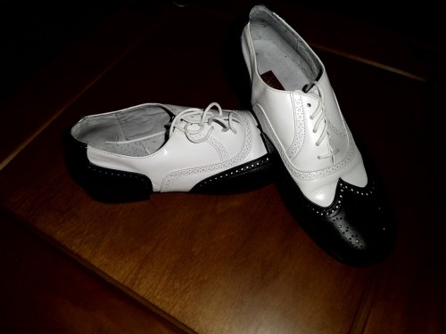 Black and white wingtip oxfords, size 10, starting bid $29