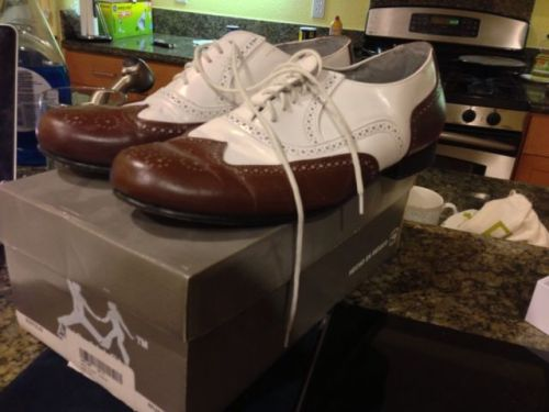 Brown and white wingtip oxfords, size 10.5, starting bid $40