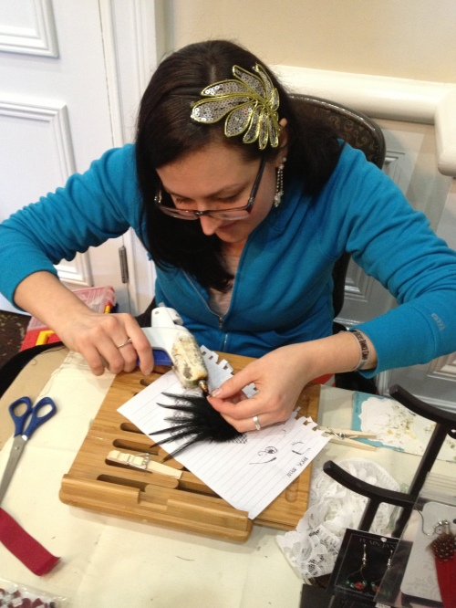 Zoe hard at work on a feathered piece.