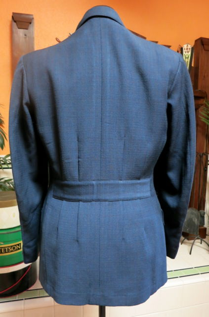 This blue action back is part of a three piece suit and the jacket is double breasted