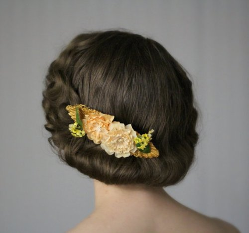 Marigolds, tiny yellow flowers, and straw on a hair comb