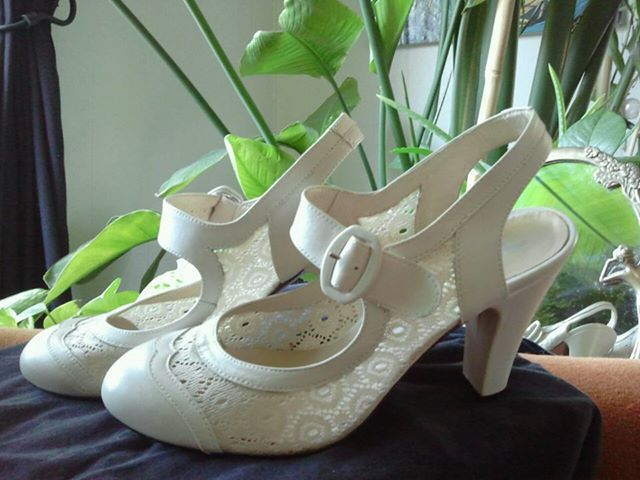 Re-mix Ginger heels in ivory, size 9, worn once, $165.00 starting bid - still a bit pricey for used shoes, but maybe the seller will consider lower offers?