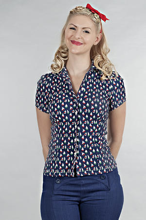 For those days when you are washing your romper, you can settle for this adorable sailboat blouse.