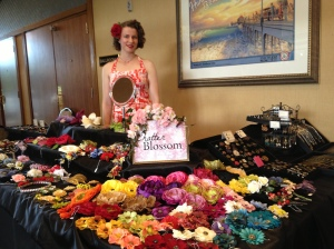 ChatterBlossom's colorful display - vintage millinery to the left