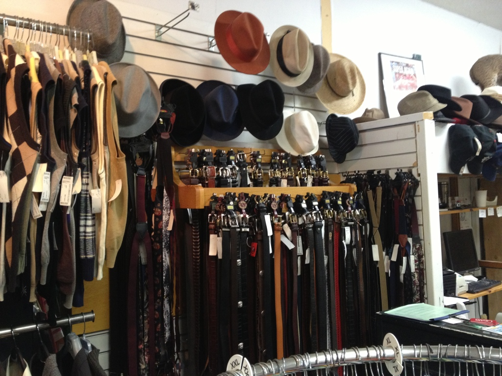 Men's accessories overflowing from the racks at the Gentleman's Closet.