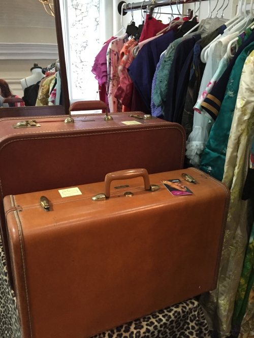 Vintage suitcases at great prices - the front suitcase came home with me; the one in the back has a garment bag mechanism inside!