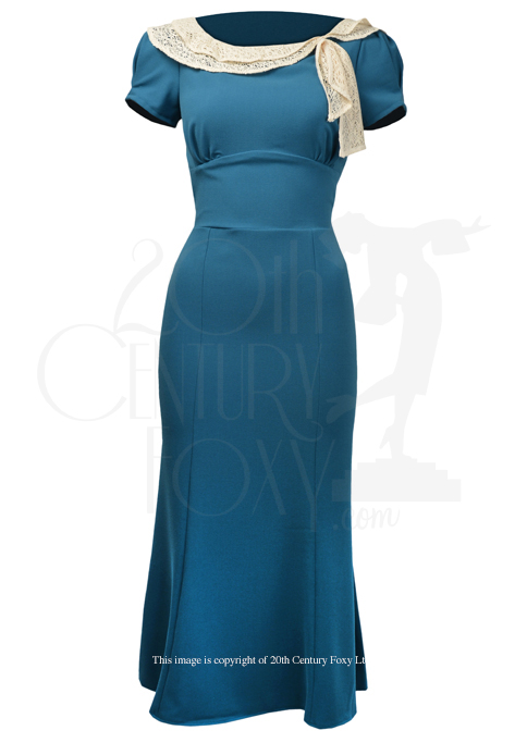 We'll file this under wishful thinking for my stature, but what a gorgeous color, shape, and that draped collar!