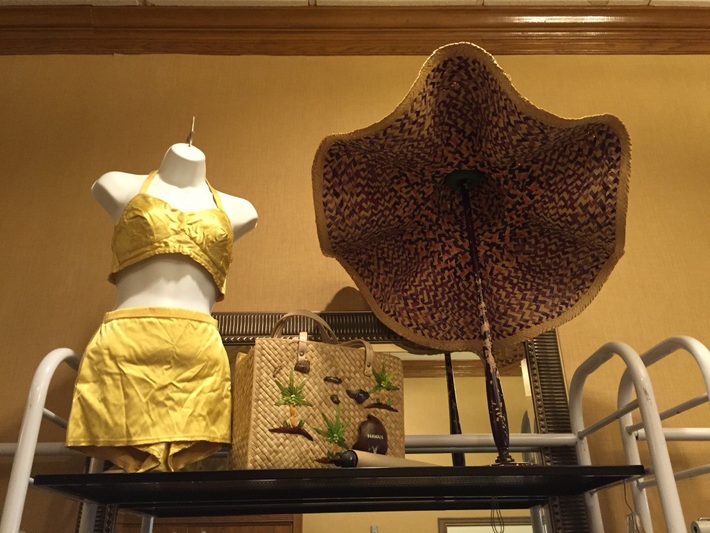 Gold bathing suit and the biggest sun hat I've ever seen, at Flower Child.